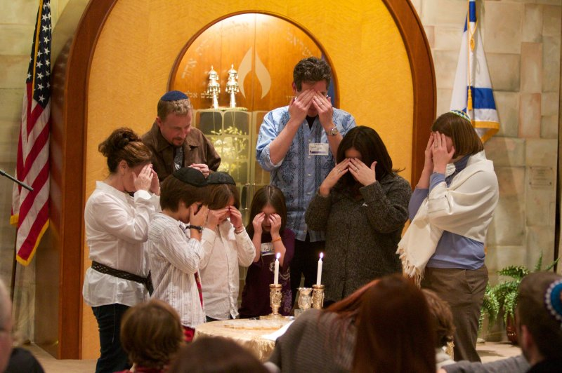 Or Ami family lighting candles