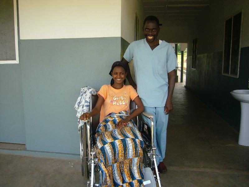 Lacina with girl in wheel chair