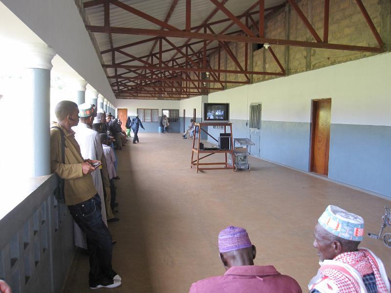 Patients waiting while Jesus film plays on veranda