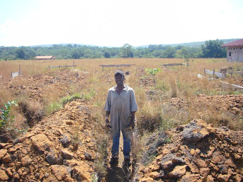 Raymond in foundation trenches