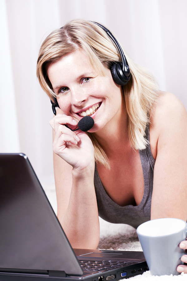 Pretty blond girl talking on the headset.