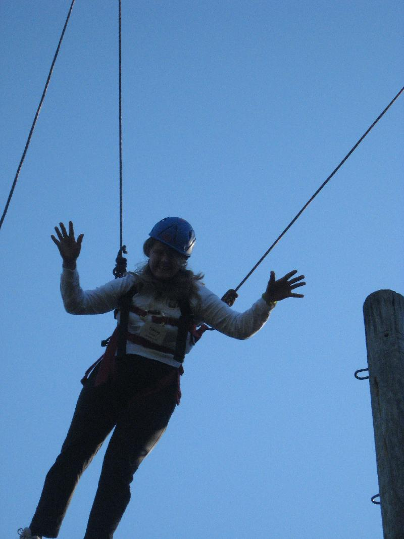 Tracey Kretzer jumps at Conscious Discipline II ropes course