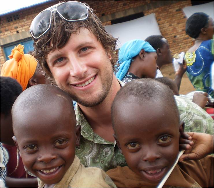 Brandon with boys in Byumba