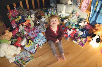 Child surrounded in Gifts