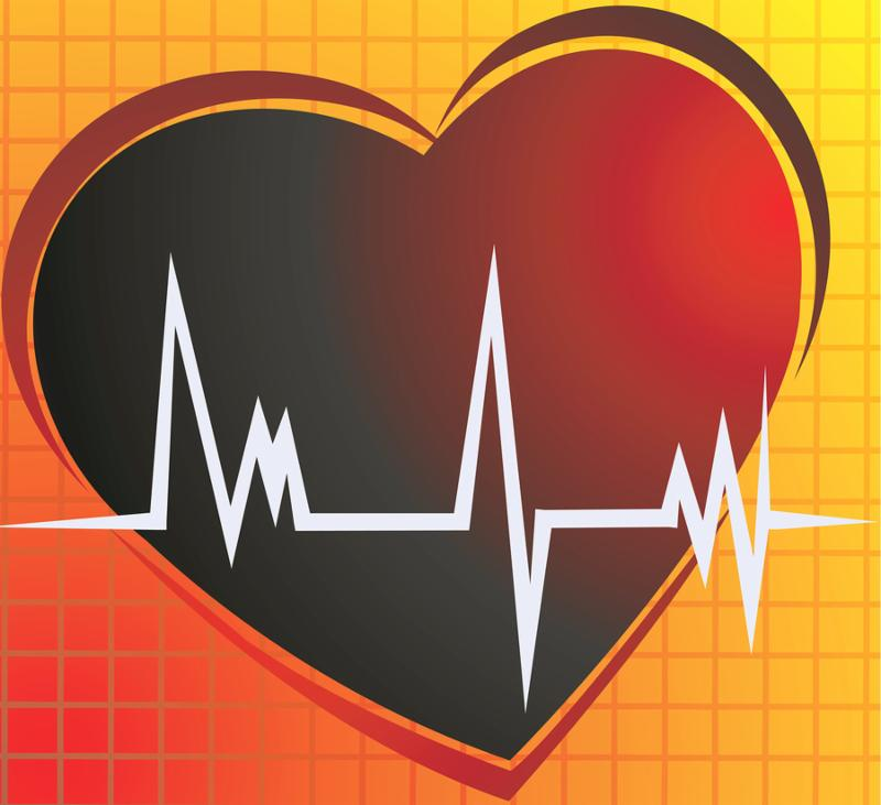 Illustration of a heart and heart pulses in yellow background