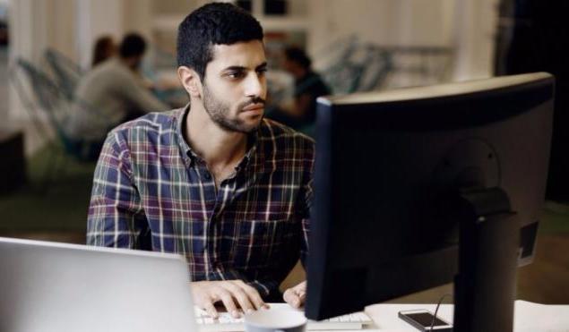 Logo designer looking at computer screen