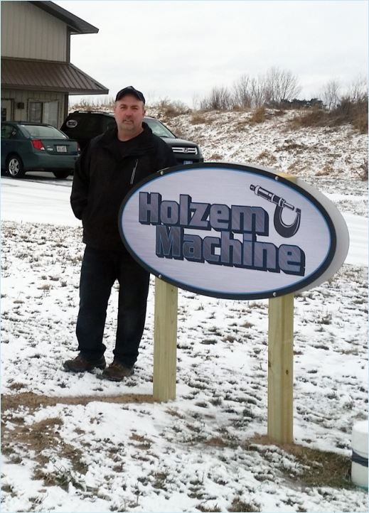 Holzem Machine store sign