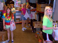 GRACE Pantry volunteers helping to sort items.