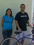 Caseworker Cindy Gayle and Jose with his new bicycle.