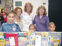 Womens Division Members pose with School Supply recipients.