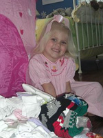 Daisy Grace poses with the donated socks!