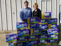 GV Rotary Club members deliver diapers collecte by the club