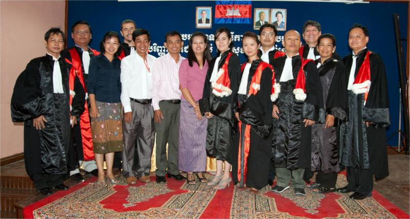 HVO volunteer poses with graduates of DPH Project, Cambodia