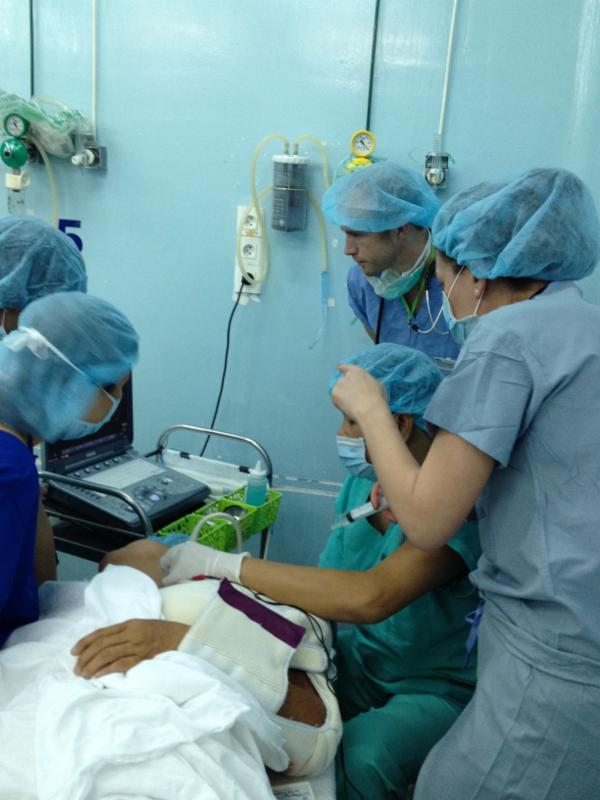 Anesthesia fellow working with local providers in Vietnam