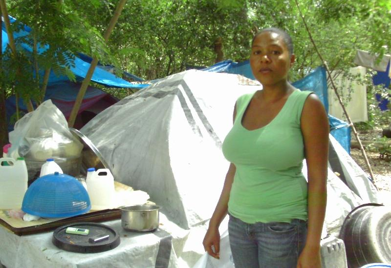 Mirlande by her tent.