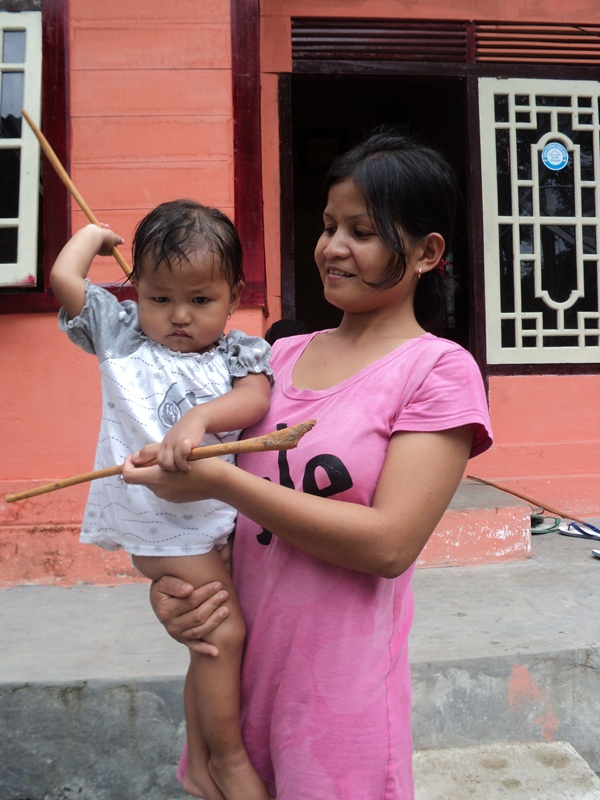 Indonesian Beneficiary Eva with her daughter