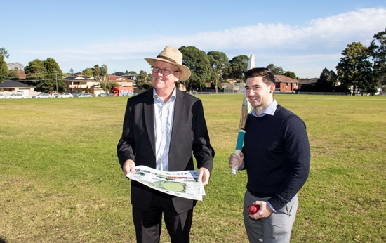 Cumberland Council General Manager, Malcolm Ryan and Graduate Communications Officer, Michael Petkovic with the plans for the upgrade of Auburn Park.