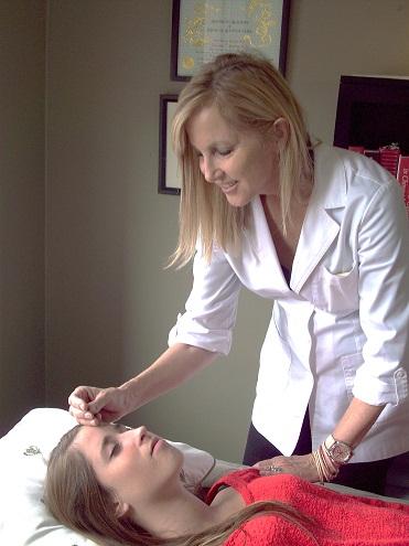 Dr. Sparrow giving a treatment