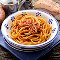 Bowl of spaghetti with amatriciana sauce.