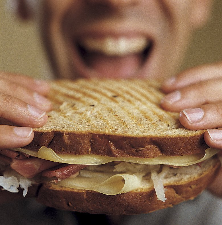 person eating sandwich