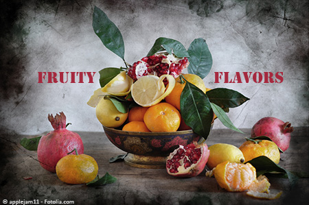 Fruit bowl filled with oranges, lemons, and pomegranates, decorated with citrus leaves. Whole and partially opened fruits are on the table beside the bowl. Text says,