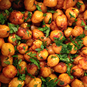 Chickpeas seasoned with smoked paprika and fresh parsley.