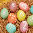 Dyed Easter eggs with numbers and letters on them.