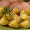 Roasted potatoes garnished with fresh rosemary.