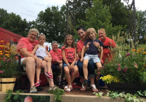 Photo of some of the Hillermann family members on the Hillermann float in the 2016 Washington Town & Country Fair Parade