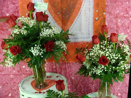Red rose flower arrangements available at Hillermann Nursery and Florist
