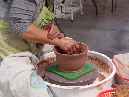 Noreen throwing pottery on the wheel at the Pot Shop inside Hillermann Nursery and Florist