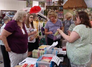 Ladies at a booth at the 2010 Ladies' Night Out