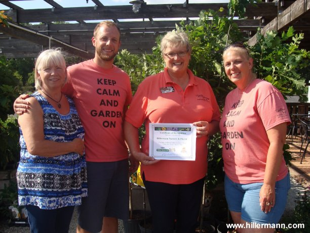 Hillermann Nursery & Florist Recognized as Pollinator Pantry Provider -  In the photo from left is MaryAnn Fink - St. Louis County Parks Pollinator Pantry Garden program, Tyler King - Marketing Coordinator for Hillermann Nursery & Florist, Sandi Hillermann