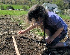 Girl planting in the garden