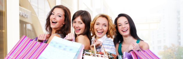 Picture of ladies with shopping bags having fun