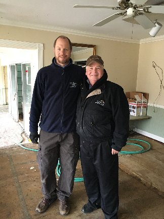 Scott Hillermann and Ken Coleman at Coleman Florist in Pacific, MO after the December 2015 flood.