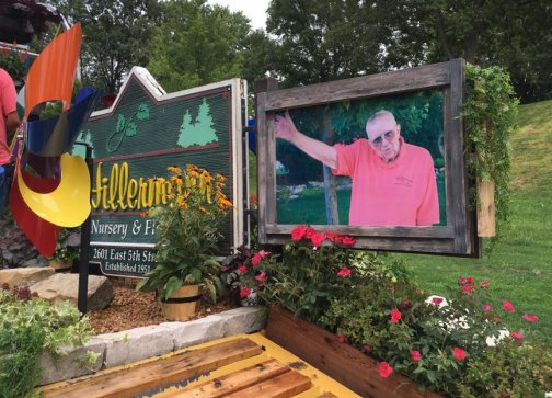 Photo of the memorial picture of Bernie Hillermann waving on the Hillermann float in the 2016 Washington Town & Country Fair Parade
