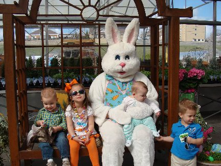 Easter Bunny with our cashier Debbie C's grandchildren at Hillermann Nursery and Florist