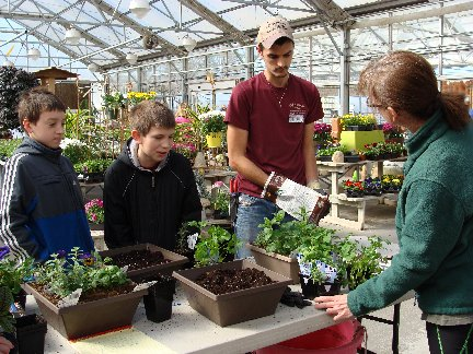 Make-N-Take workshop participants with our greenhouse staff member, Brandon at Hillermann Nursery and Florist