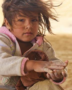 Syrian girl awaits assistance