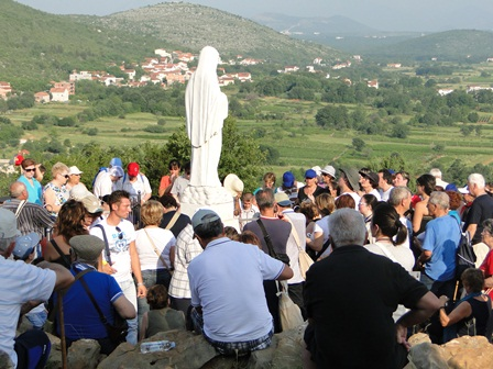 people on Apparition Hill near Our Lady's statue