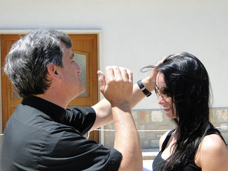 A priest blessing a young woman in Medjugorje