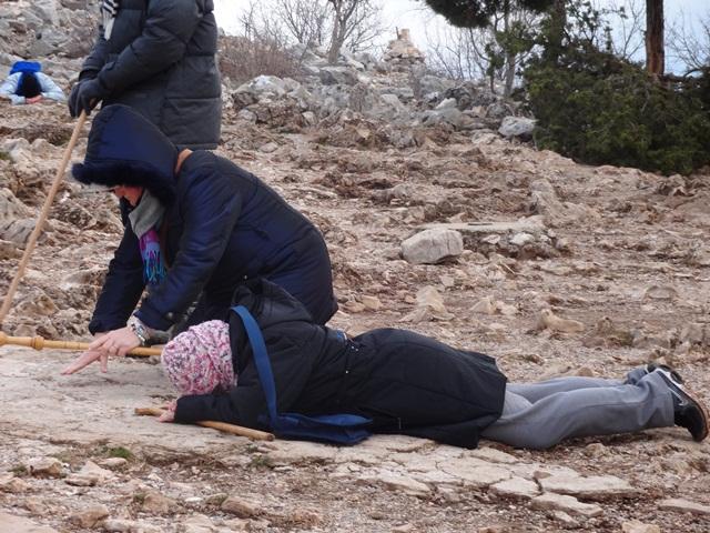 prostrate pilgrim on Kriz