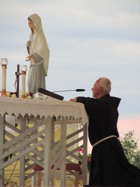 Priest at altar praying