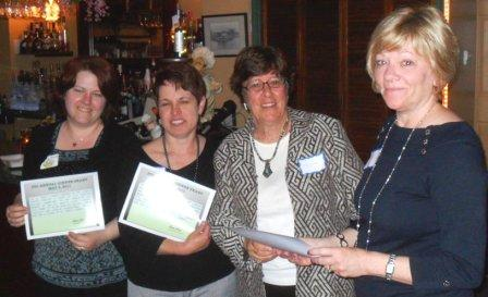 Branch Managers receiving certificates from Louise Snell