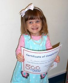 Little girl with certificate