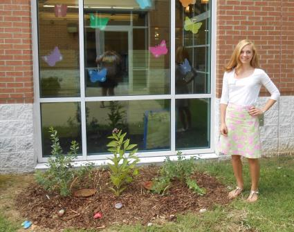 Rachel Adler in front of butterfly garden