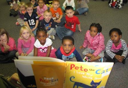 Head Start students listening to story