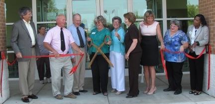 Board members cutting ribbon