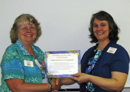 Joan Springer presenting Kathy Faubion a certificate
